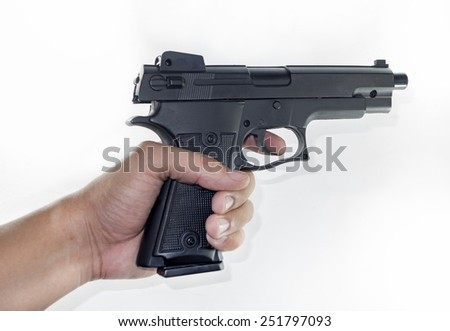 hand holding a handgun - stock photo