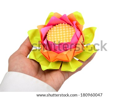 Hand holding a lotus origami on a white background. - stock photo