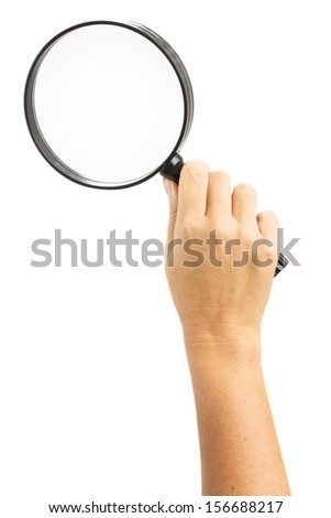 Hand holding a magnifying glass isolated on white background - stock photo