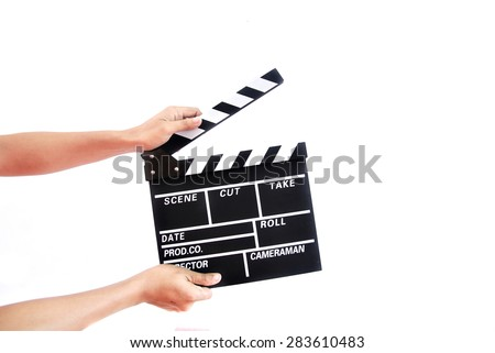 Hand holding a movie director scene card on white background. - stock photo