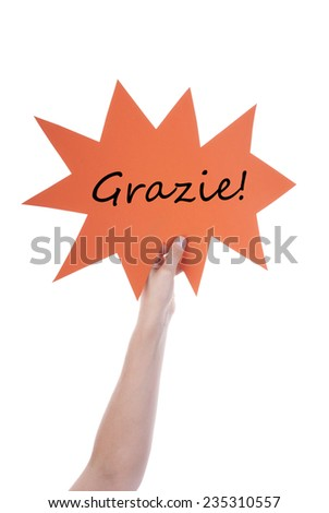 Hand Holding A Orange Speech Balloon Or Speech Bubble With Italian Grazie. Isolated Photo - stock photo