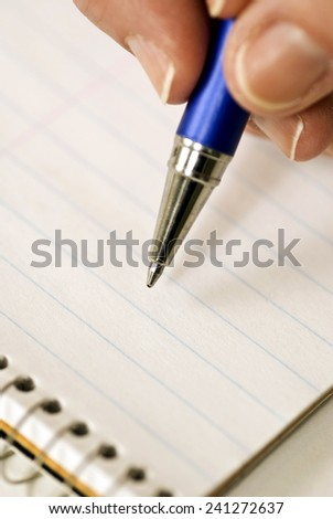 Hand Holding A Pen Ready To Write - stock photo
