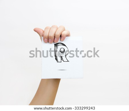 Hand holding a piece of paper with sketchy capital letter  R, isolated on white. - stock photo
