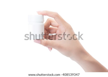 Hand holding a pill bottle isolated on white with clipping path. - stock photo