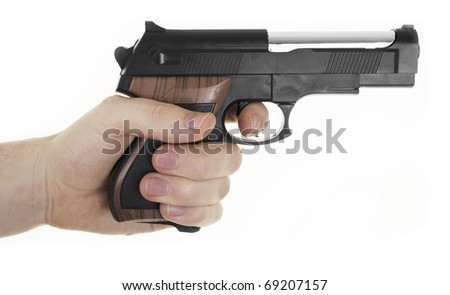 Hand holding a pistol. isolated on white background - stock photo