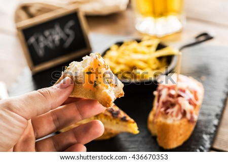 Hand holding a portion of smoked salmon snack, copy space. - stock photo