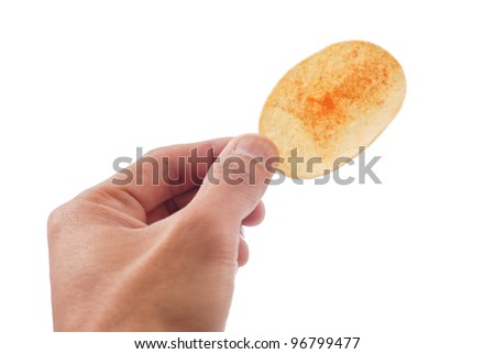 hand Holding a potato chip - stock photo