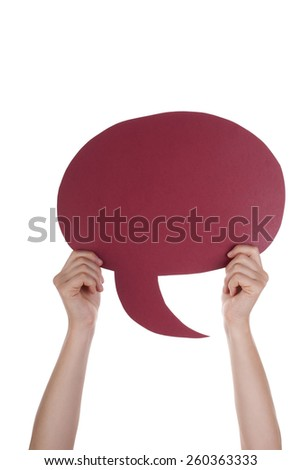 Hand Holding A Red Empty Speech Balloon Or Speech Bubble. Isolated Photo With Copy Space Or Your Text Here - stock photo