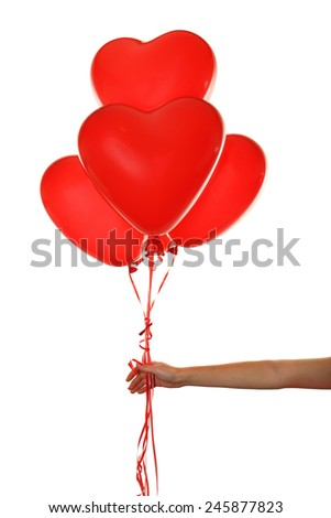Hand holding a red heart balloons isolated on white - stock photo