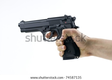 hand holding a semi automatic handgun - stock photo