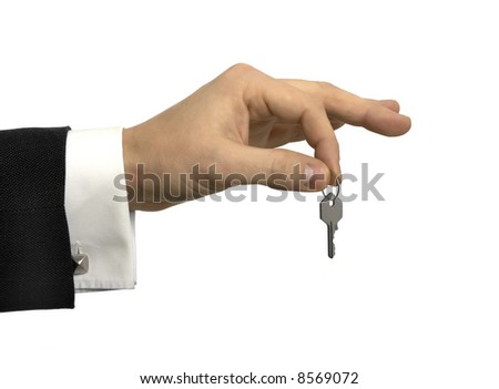 Hand holding a small key - stock photo