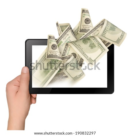 Hand holding a tablet with flying off money. Electronic business concept - stock photo
