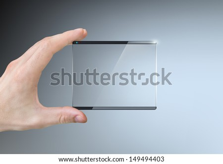 hand holding a transparent touch screen - stock photo
