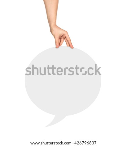 Hand holding a white round  blank speech bubble on an isolated white background - stock photo