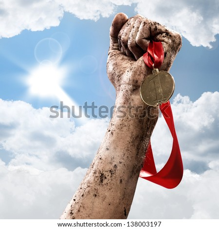hand holding a winner's medal, success in competitions - stock photo