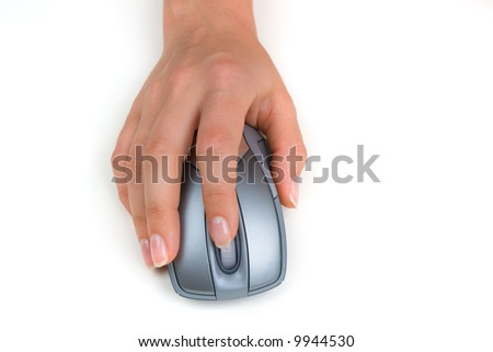 Hand holding a wireless computer mouse - stock photo