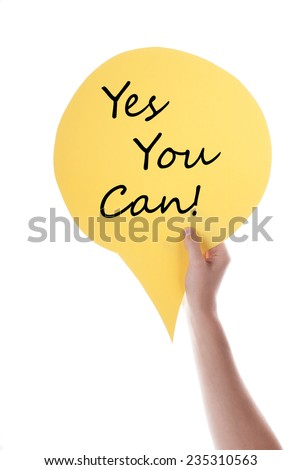 Hand Holding A Yellow Speech Balloon Or Speech Bubble With Yes You Can. Isolated Photo. - stock photo