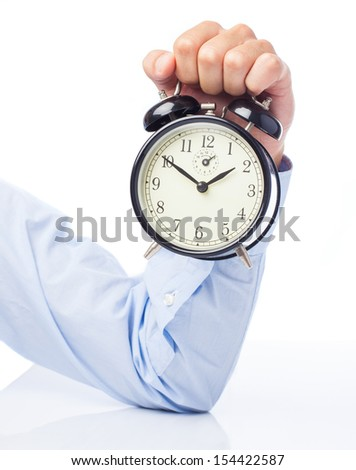 hand holding alarm clock isolated on a white background - stock photo