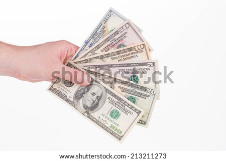 Hand holding american dollar bills. Isolated on a white background. - stock photo
