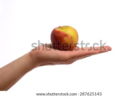 Hand holding an apple on a white background - stock photo