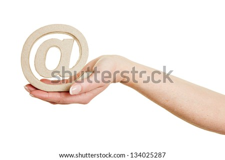 Hand holding an at sign as internet symbol - stock photo