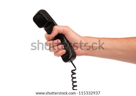 Hand holding an old black telephone tube isolated on white background - stock photo