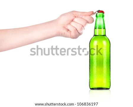 hand holding and opening beer bottle with metal opener - stock photo