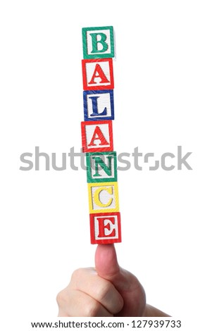 Hand holding balance word - stock photo