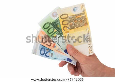 Hand holding bank notes - stock photo