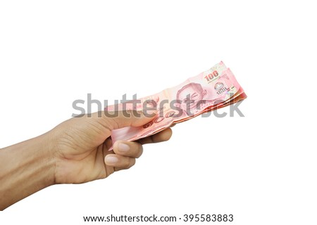 Hand holding banknotes isolated on white, Hand holding thai money isolated on white background - stock photo