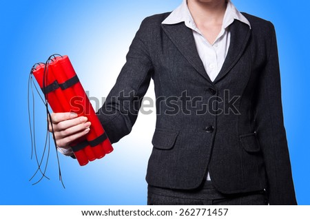 Hand holding bars of dynamite on white - stock photo