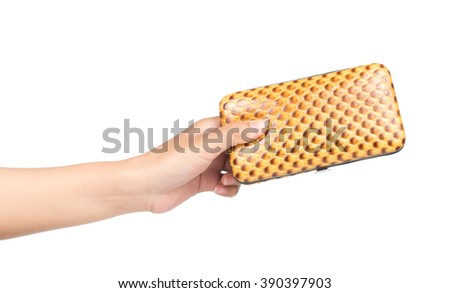 Hand holding beautiful of leather bag isolated on white background - stock photo