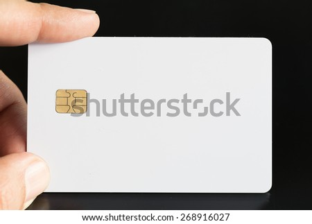 Hand Holding Blank Credit Card With Electronic Chip - stock photo