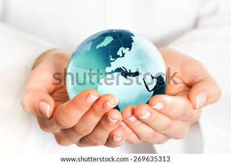 Hand holding blue earth globe - stock photo