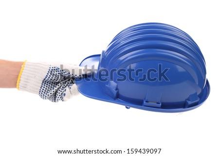 Hand holding blue hard hat. Isolated on white background. - stock photo