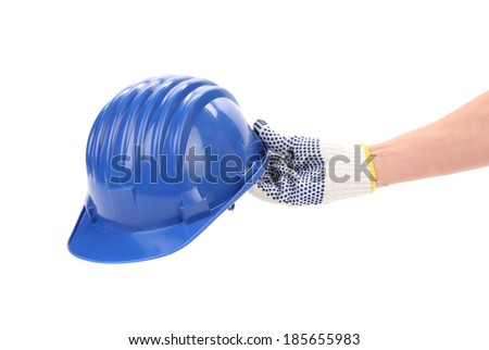 Hand holding blue helmet. Isolated on a white background. - stock photo