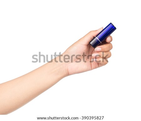 Hand holding blue Lipstick isolated on white  - stock photo