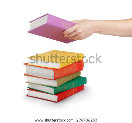 Hand holding book isolated on white - stock photo