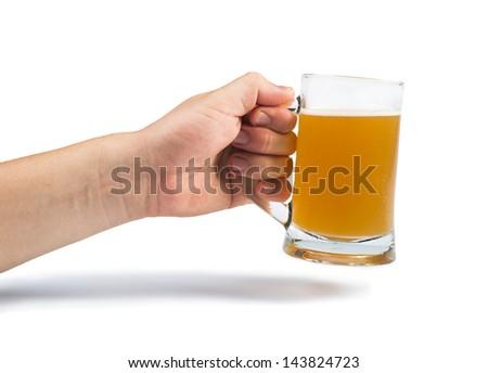 Hand holding bottle of beer and beer mug. White isolated studio shot. - stock photo