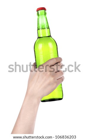 hand holding Bottle of beer with drops isolated on a white background - stock photo