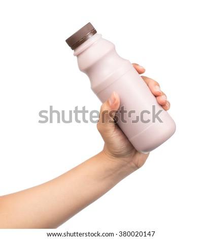 Hand holding Bottle of fresh milk chocolate isolated on white background. - stock photo