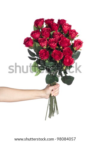 Hand holding bouquet of red roses over white background - stock photo