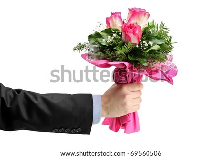 Hand holding bunch of roses isolated against white background - stock photo