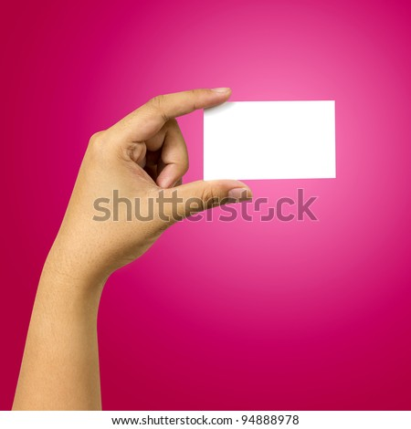 hand holding business card against red background - stock photo