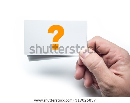 Hand holding business card with question mark on the white wall - stock photo