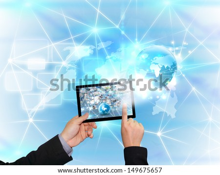 hand holding business world on tablet pc  - stock photo