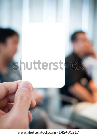 "Hand holding card in the serious meeting. Able to put any message in there such as ""Relax Time :)"". - stock photo"