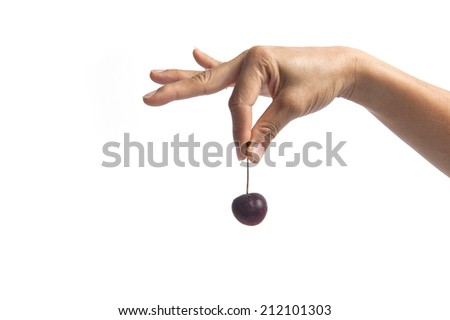 Hand holding cherries isolated on white - stock photo