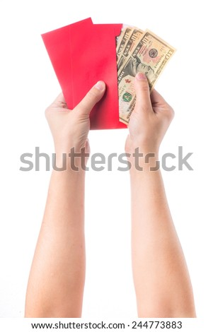 Hand holding chinese red envelope with money isolated over white background - stock photo