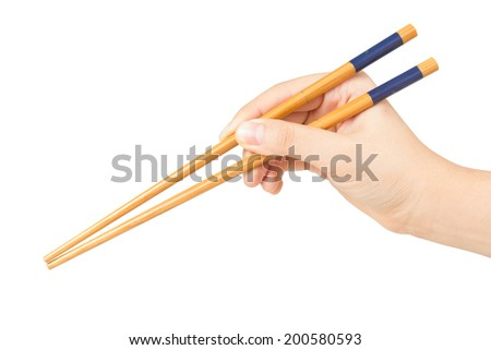 Hand holding chopstick isolated on white background. Save with clipping path. - stock photo